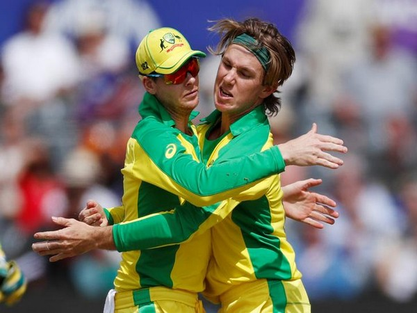 Adam Zampa celebrates with Steve Smith after taking a wicket against Afghanistan