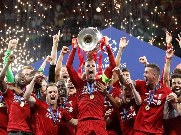 Liverpool FC with the Champions League trophy