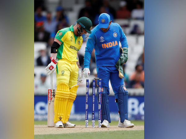 India's MS Dhoni inspecting the bails during a World Cup against Australia