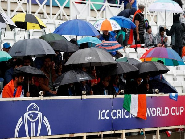 Fans with umbrella at the Trent Bridge stadium on Thursday.