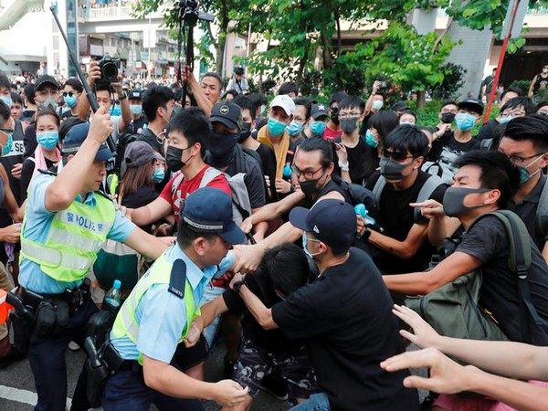 Hong Kong police try to disperse crowd after a protest took place in Sheung Shui, Hong Kong on Saturday.