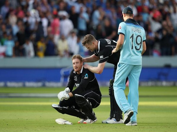New Zealand's Martin Guptill consoled by teammate James Neesham after World Cup final defeat in 2019.