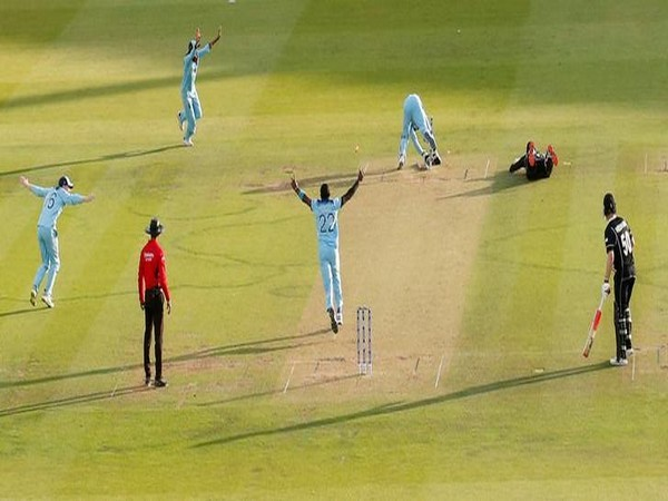 England's Jos Buttler celebrating with teammates after running out New Zealand's Martin Guptill in super over