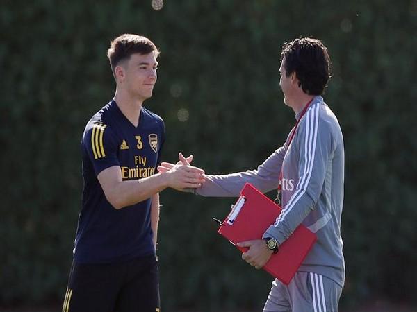 Arsenal manager Unai Emery and Kieran Tierney
