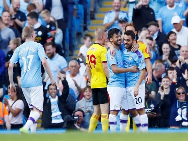 Manchester City's Bernando Silva celebrates with David Silva after scoring a goal against Watford