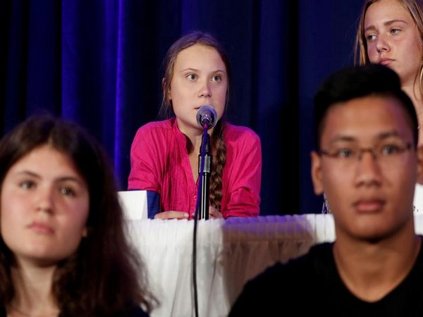 Swedish climate activist Greta Thunberg speaks with other child petitioners from twelve countries