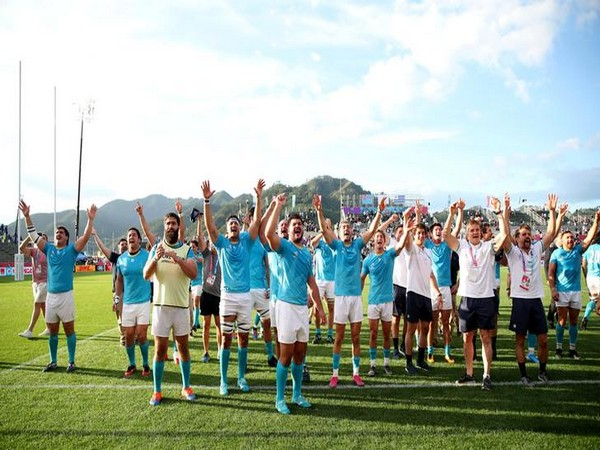 Uruguay players celebrate victory over Fiji in the Rugby World Cup