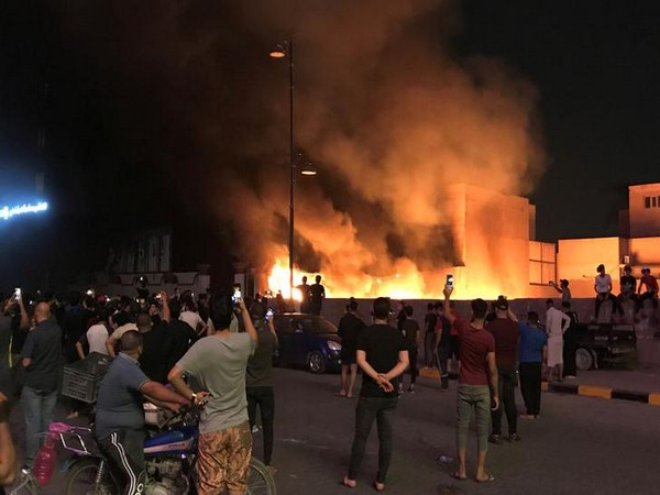 Demonstrators set on fire the Hikma movement building during a protest over unemployment, corruption and poor public services, in Najaf, Iraq Oct 2