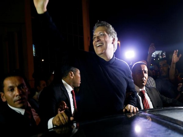 Tunisian presidential candidate Nabil Karoui greets his supporters after he was freed,