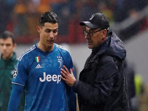Juventu's Cristiano Ronaldo (left) with manager Maurizio Sarri (right)
