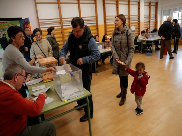 A man casts his vote during general election in Madrid on Sunday. Photo/Reuters