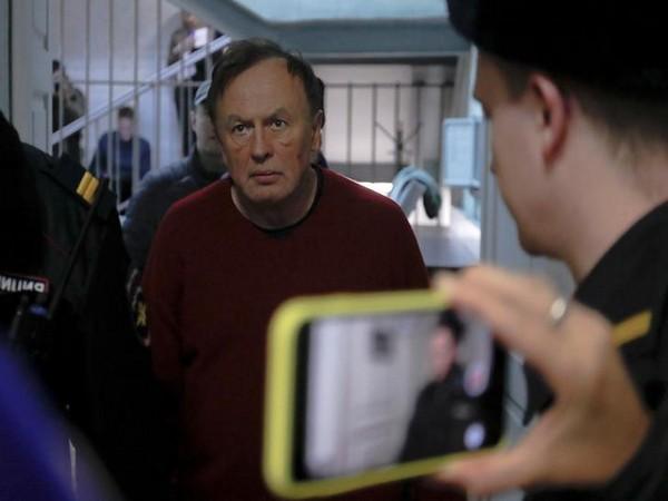 Russian historian Oleg Sokolov escorted before a court hearing in Saint Petersburg