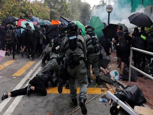 The financial hub of Asia is witnessing turmoil for another day after a man was shot at and another was set alight following a confrontation with protestors yesterday.