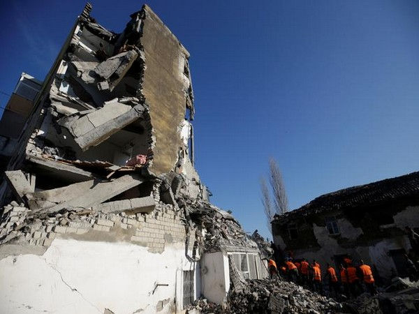 Emergency personnel work near a damaged building in Thumane, after an earthquake hit Albania.