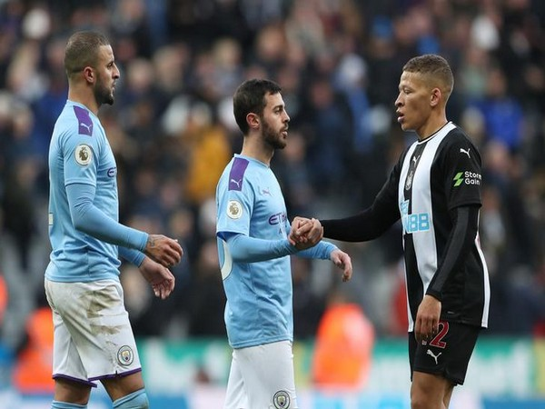 Newcastle United's Dwight Gayle with Manchester City's Bernardo Silva and Kyle Walker