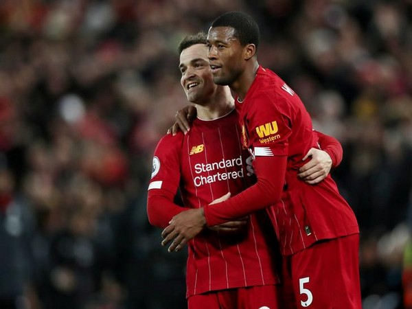 Liverpool's Georginio Wijnaldum celebrates with Xherdan Shaqiri