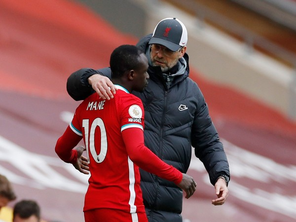 Liverpool striker Sadio Mane with manager Jurgen Klopp