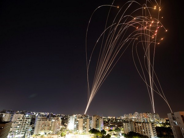 Streaks of light observed as rockets launched from Gaza towards Israel (Credit: Reuters Pictures)