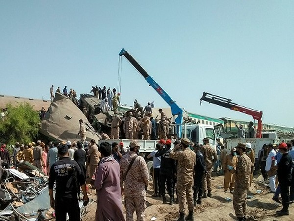 Paramilitary personnel and rescue workers gather at the site following a collision between two trains in Ghotki, Pakistan June 7, 2021. (Photo credit: REUTERS)