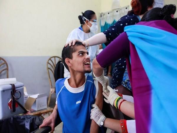 A man receives a dose of Johnson & Johnson COVID-19 vaccine against the coronavirus disease (COVID-19) at Nepal Disabled Association Khagendra New Life Centre in Kathmandu. (Photo Credit: Reuters)