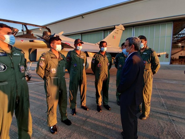 Indian ambassador to France interacts with pilots of Rafale jets with tail no RB-005 in the background