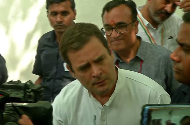 Congress president Rahul Gandhi speaking to the media after casting his vote in New Delhi on Sunday. (Photo/ANI)