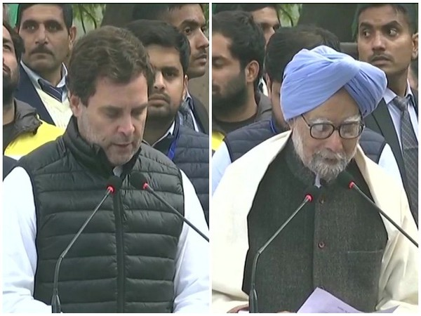 Congress leaders Rahul Gandhi and Manmohan Singh read Preamble of Constitution during a protest against CAA and NRC at Rajghat in New Delhi on Monday. Photo/ANI