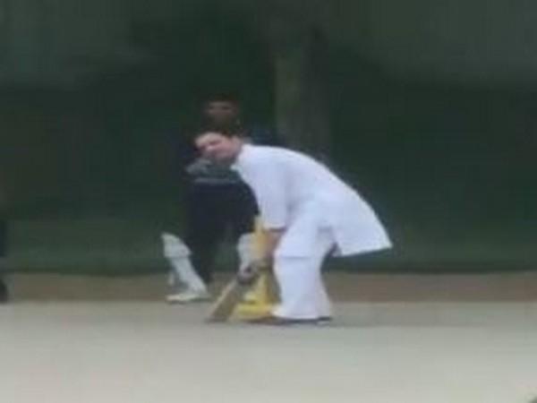 Congress leader Rahul Gandhi playing cricket with local boys in Rewari, Haryana on Friday. Photo/ANI