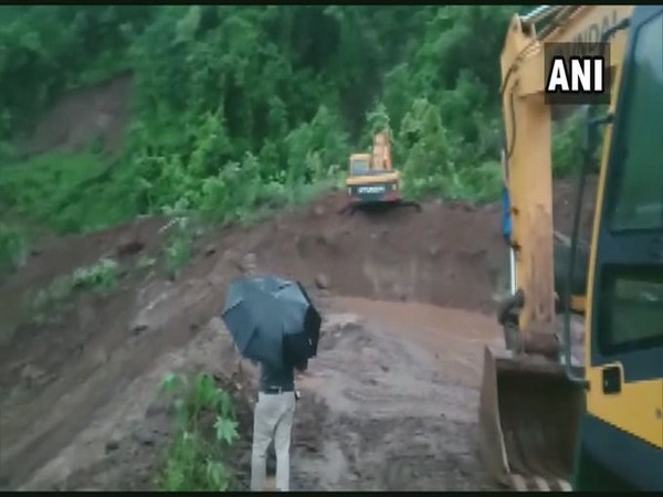 Maharashtra Police and administration clearing debris from the Mumbai-Goa highway in Raigad. [Photo/ANI]