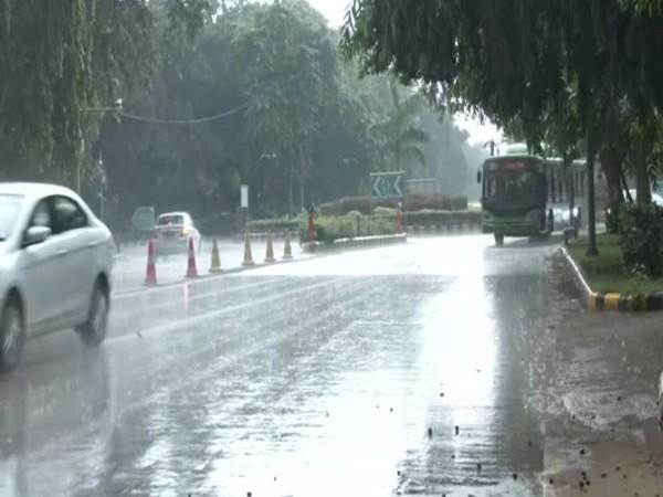 Visual of rain from Janpath road, New Delhi