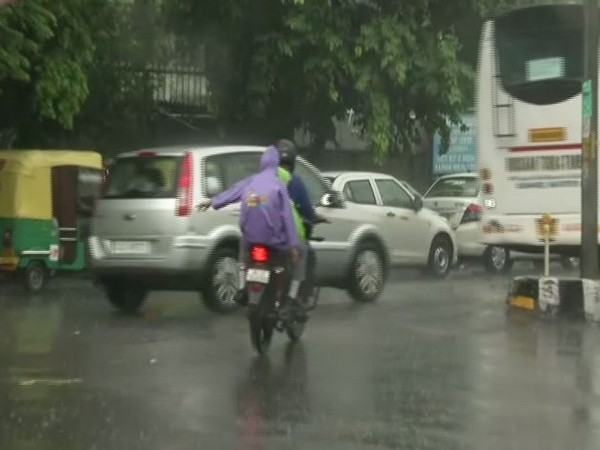 The capital witnessed heavy rainfall on Tuesday morning, bringing respite to people from the humid weather. Photo/ANI