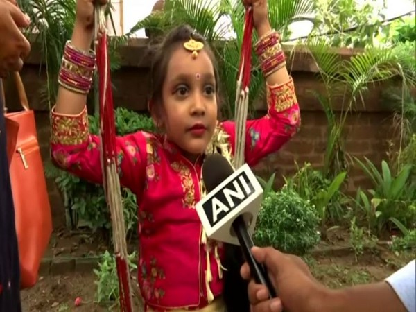 A girl celebrating 'Raja Parba'. Photo/ANI