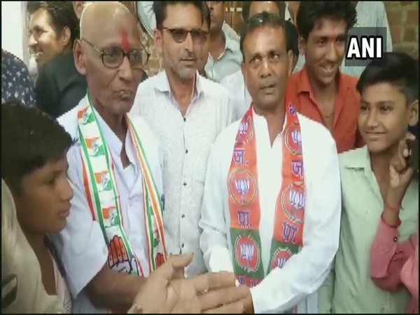 Congress worker, Bapu Lal Sen shaves his head  in Rajgarh on Saturday after losing a bet