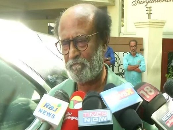 Actor-turned-politician Rajinikanth talking to reporters on CAA