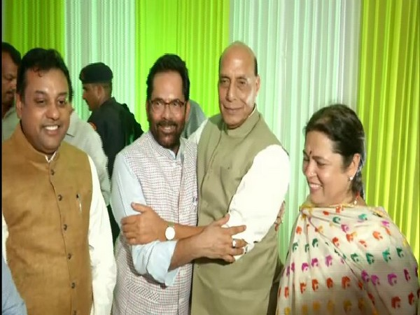 Union Defence Minister along with others at the residence of Union Minority Affairs Minister Mukhtar Abbas Naqvi in New Delhi on Wednesday. Photo/ANI
