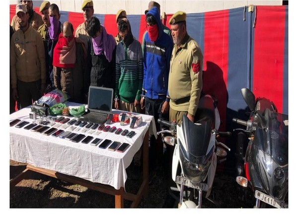 Jammu and Kashmir Police team with the thieves and recovered property in Rajouri. Photo/Twitter