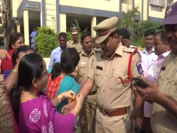 Women tied rakhis on police officer's hands in Telangana on Friday. (Photo/ANI)