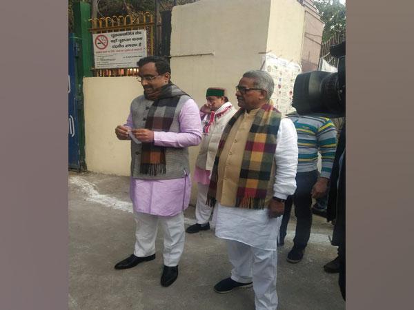 RSS joint general secretary Krishna Gopal and BJP's senior leader Ram Madhav at polling station in Jhandewalan on Saturday morning.