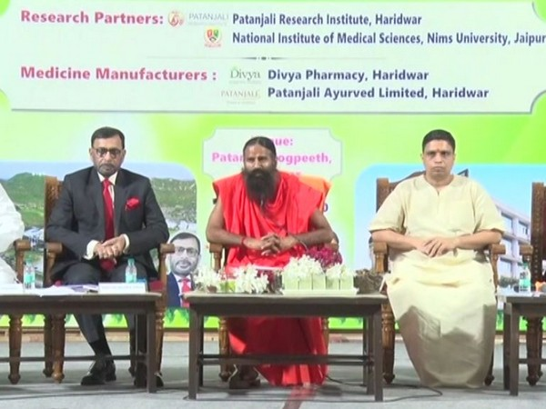 Ramdev speaking at the launch of Patanjali's Ayurvedic medicine for COVID-19 in Haridwar on Tuesday. [Photo/ANI]