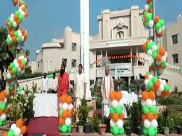Yoga guru Ramdev hoisted national flag on the occasion of Independence Day in Haridwar on Saturday. (Photo/ANI)