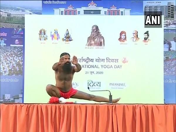 Yoga guru Baba Ramdev was seen performing yoga at Patanjali Yogpeeth in Haridwar on the occasion of International Yoga Day here on Sunday. (Photo/ ANI)