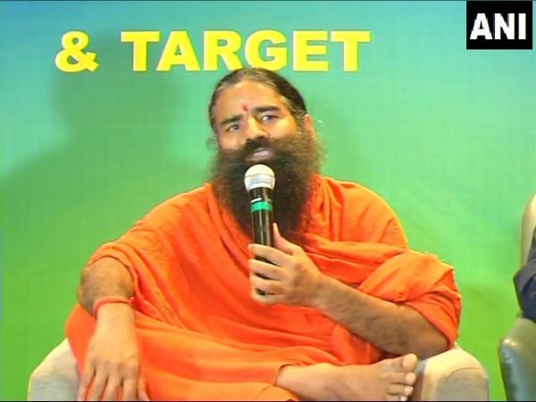 Yoga guru Baba Ramdev speaking at an event in Indore on Monday.