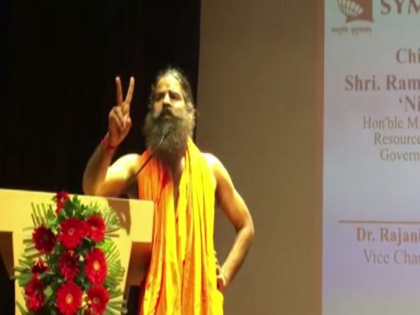 Yoga Guru Ramdev speaking at an event in Noida, Uttar Pradesh on Tuesday. Photo/ANI