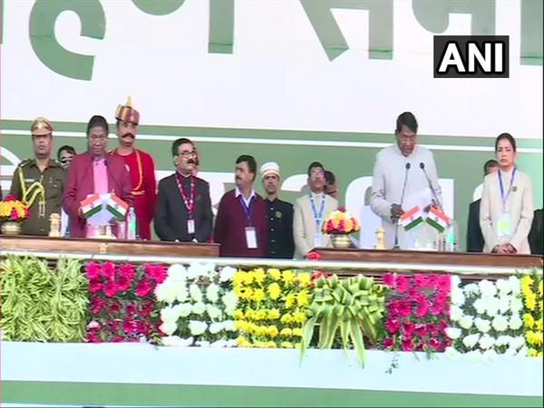Congress' Rameshwar Oraon taking oath as Cabinet Minister of Jharkhand in Ranchi on Sunday. Photo/ANI