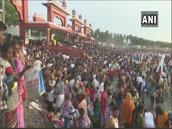 Devotees take a holy dip on 'aadi amavasya' in Rameshwaram on Wednesday. Photo/ANI