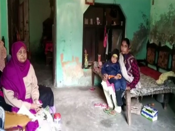 Family members of a person issued notice by the administration for vandalism in Rampur. Photo/ANI