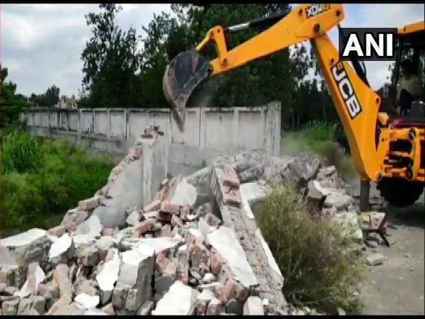 Demolition of the boundary wall of 'Humsfar' resort belonging to Abullah Azam Khan in Rampur on Friday.