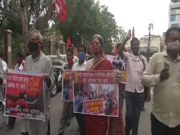 Left parties stage protests and sit-in dharna outside Ranchi Rajbhawan against the death of Stan Swamy. (Photo/ANI)