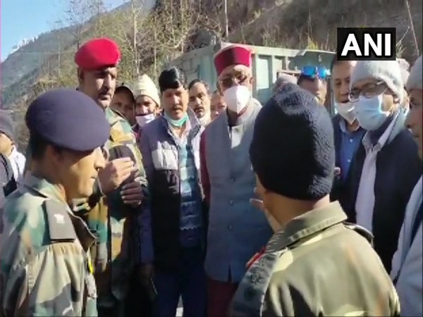 Uttarakhand Chief Minister Trivendra Singh Rawat being briefed on flood situation by Army and ITBP jawans, in Tapovan area of Chamoli district. (Photo/ANI)