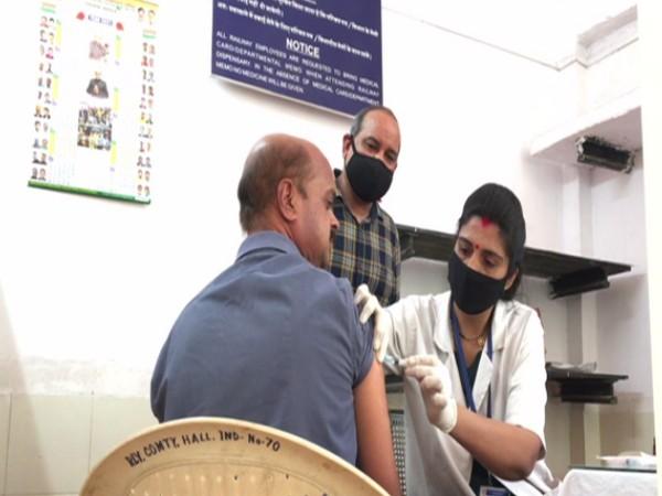 A railway employee recieving COVID-19 vaccine in Indore. (Photo/ ANI)